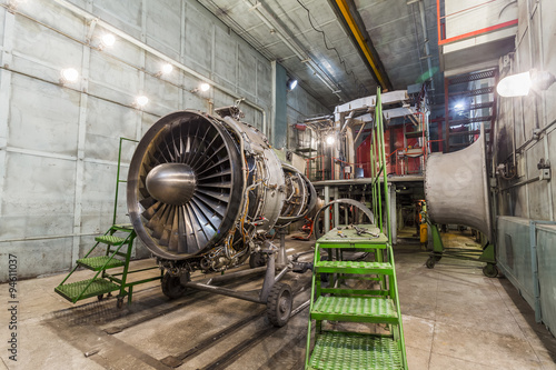 Wall mural Engine turbo fan in aviation hangar
