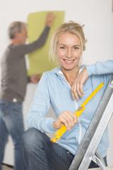 Beautiful mature woman decorating house