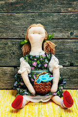 Rag doll on a wooden background