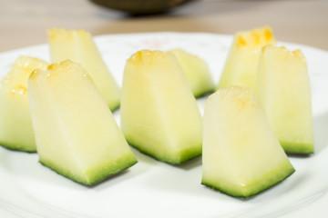 Dish with melon chunks of the Santa Claus variety