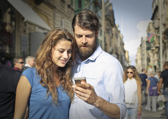 Couple using a smart phone