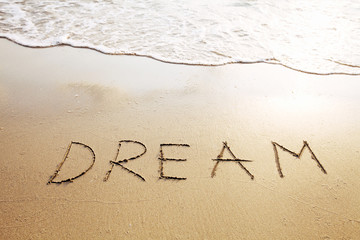 dream - word written on the beach
