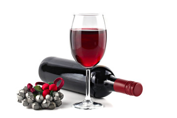 Red wine with Christmas ornament isolated on white background, s