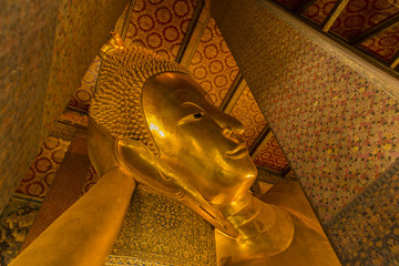 the reclining buddha image in a wat po temple
