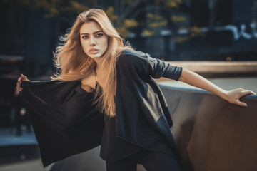 Beautiful young model woman posing in modern architecture environment
