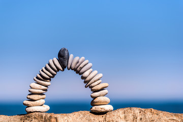 White arch of pebbles