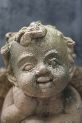 baby cupid,Sculpture at a Melbourne cemetery.