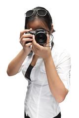 Woman photographer taking a photo on white background