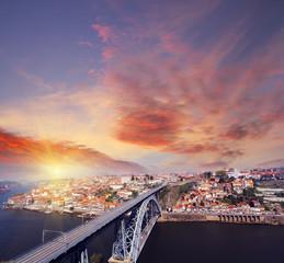 view of Douro riverside and Dom Luiz bridge  Porto Portugal at sunset