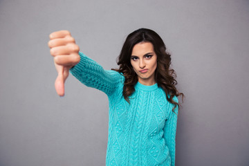 Young woman showing thumb down