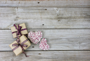 Brown paper packages and rope hearts on rustic background