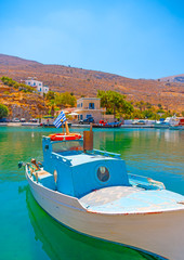 traditional fishing boat  docked at the port of Vathi village in Kalymnos island in Greece