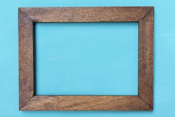 Wooden frame on blue background