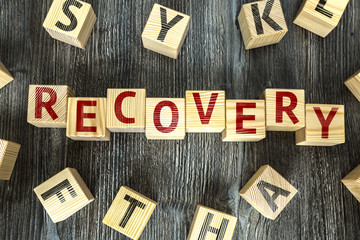 Wooden Blocks with the text: Recovery