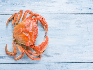 Cooked crab on old blue wooden table.