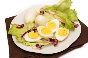 Hard Boiled Eggs with fresh vegetable garnish