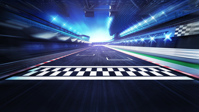 finish line on the racetrack with spotlights in motion blur