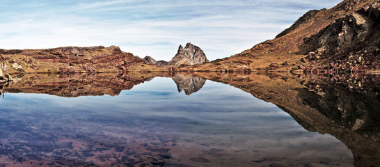 Mirror reflection in small lake of Anayet plateau