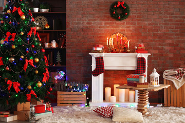 Fireplace with beautiful Christmas decorations in comfortable living room