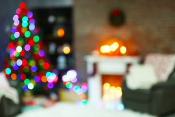 Holiday decorated room with Christmas tree, out of focus shot for photo background