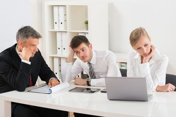 Businesspeople Getting Bored In Office