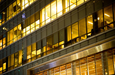 Office building windows lit up at night