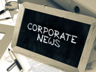 Corporate News Handwritten by White Chalk on a Blackboard.