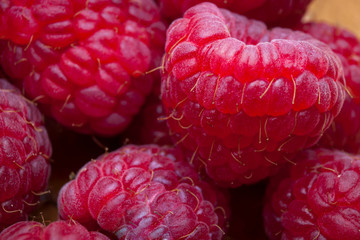 Macro image of a heap of red raspberries a refreshing snack option for a healthy life