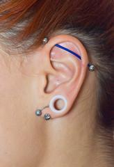girl ear with piercings