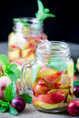 Jar delicious refreshing drink of peach fruits and plum  with mi