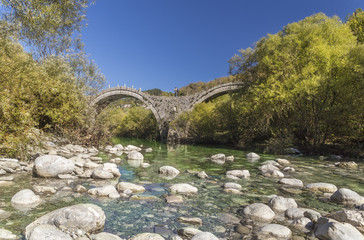 Ioannina Zagoria, Kalogeriko old arch bridge, autumn, river