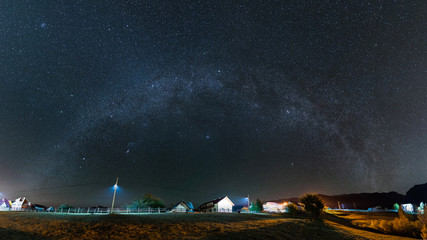 Milky Way over the village at Pestera, Bran, Romania