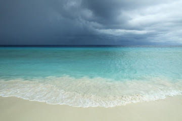 Tropical beach and strom clouds on Little Curaçao, Netherlands