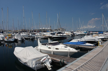 Motor boats and sailboats in harbor in Trieste, Italy