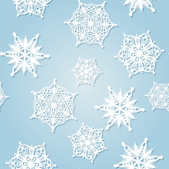 Seamless pattern with falling snowflakes.
