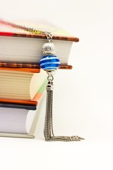 Necklace and books