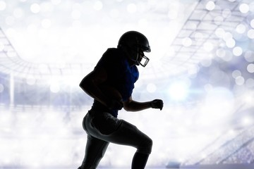 Composite image of silhouette american football player runing