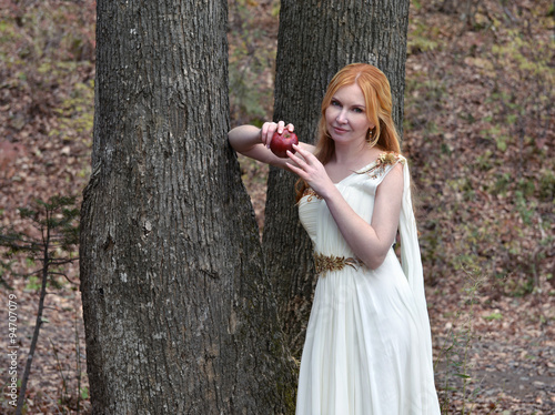 f871860bb Beautiful fairy girl wearing white dress and holding apple.
