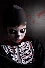 Boy in Halloween skeleton costume