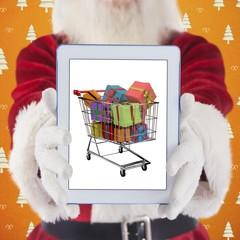 Composite image of santa presents a tablet pc