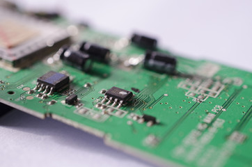 Microchip circuit board close up green on white background technology with bokeh