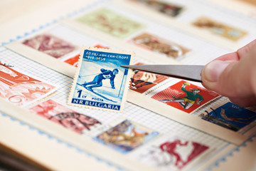 Postage stamp with skier on album