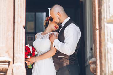 beautiful young couple, wedding photos indoors near a window