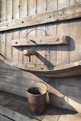 big wooden wine barrel with faucet