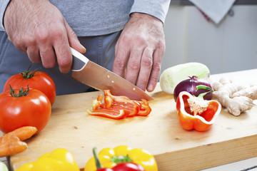 Preparing fresh organic food. Cutting vegetables