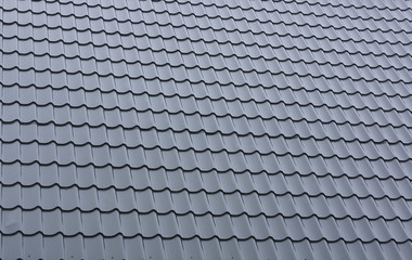 Part of a tiled roof of metal.