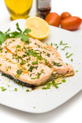 Poached salmon with extra virgin olive oil and parsley