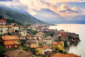 View of Como Lake, Milan, Italy, on sunset with Alps mountains i