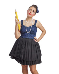 portrait of a pin up woman holding a big pencil