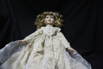 Creepy old, antique doll that looks like it is floating, possessed or haunted.
